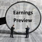 Magnifying glass focused on earnings preview