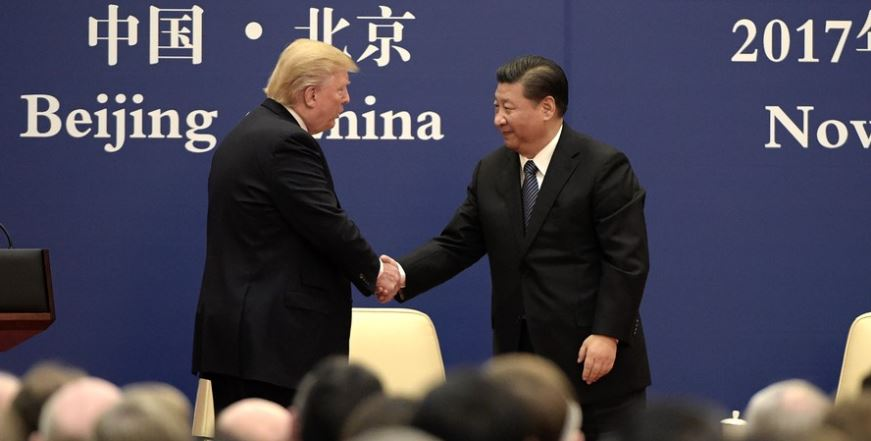 Trump shaking hands with Chinese Prime Minister