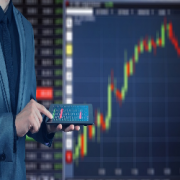 Guy with a tablet looking at Stock Market Index_300x250